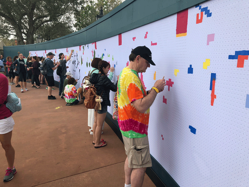 People painting the Epcot mural
